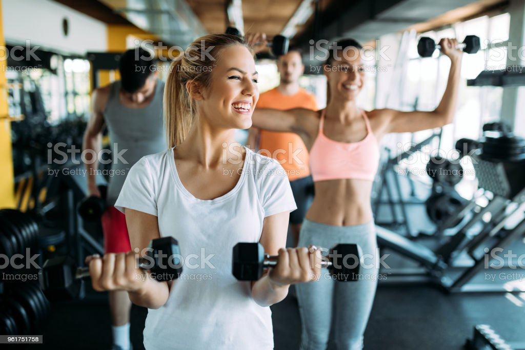 Picture of two fitness women in gym stock photo