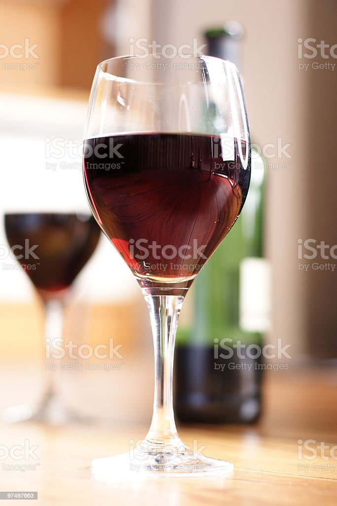 A picture of two glasses with red wine in them royalty-free stock photo