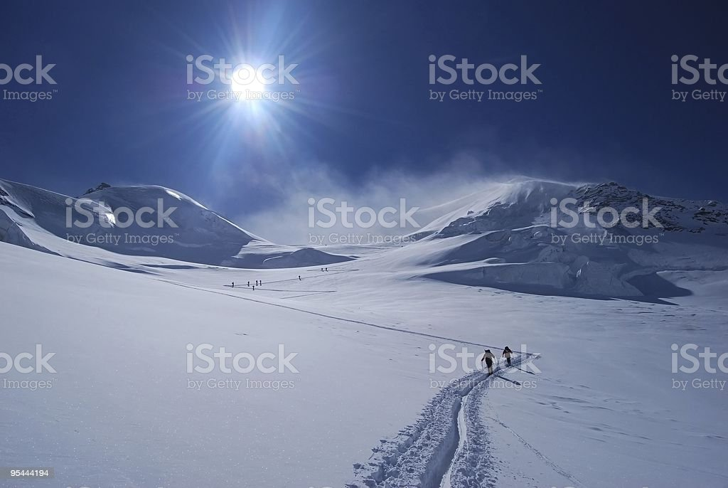 Picture of two people ski mountaineering stock photo