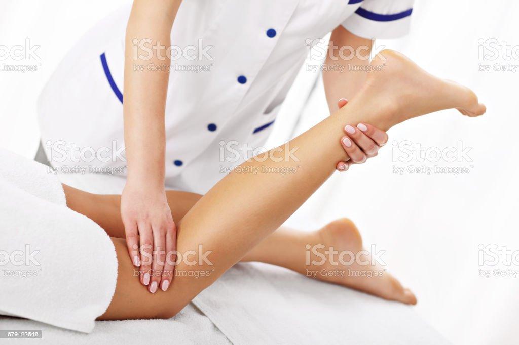 A picture of woman having leg therapy photo libre de droits