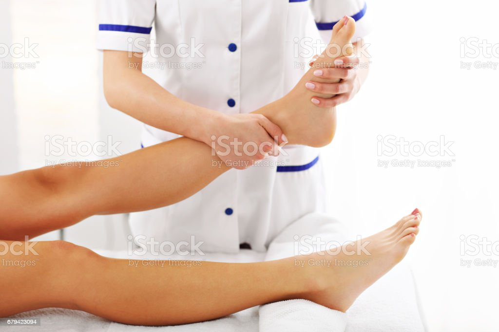 A picture of woman having leg therapy foto de stock royalty-free