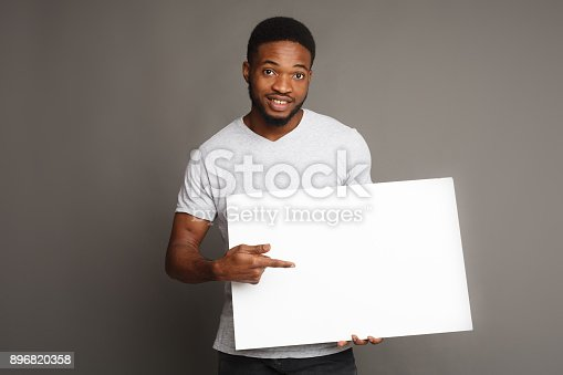 1159989540 istock photo Picture of young african-american man holding white blank board 896820358