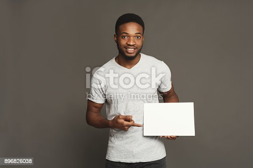 1159989540 istock photo Picture of young african-american man holding white blank board 896826038