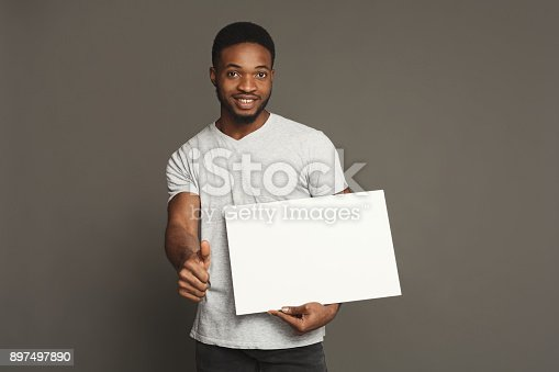 896826068 istock photo Picture of young african-american man holding white blank board 897497890