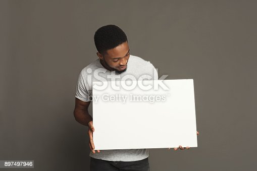 896826068 istock photo Picture of young african-american man holding white blank board 897497946