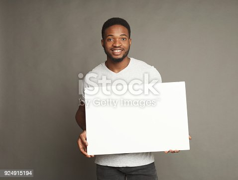 896826068 istock photo Picture of young african-american man holding white blank board 924915194