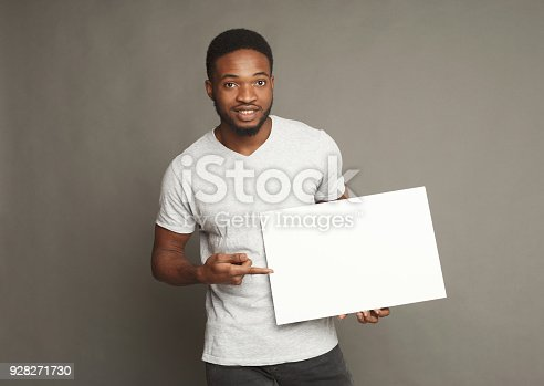 896826068 istock photo Picture of young african-american man holding white blank board 928271730