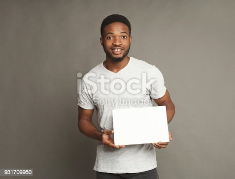 896826068 istock photo Picture of young african-american man holding white blank board 931709950