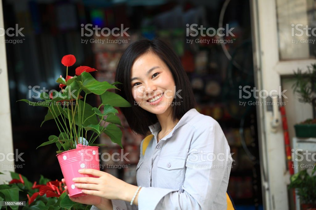 picture of Young Asian woman flowers in florist royalty-free stock photo