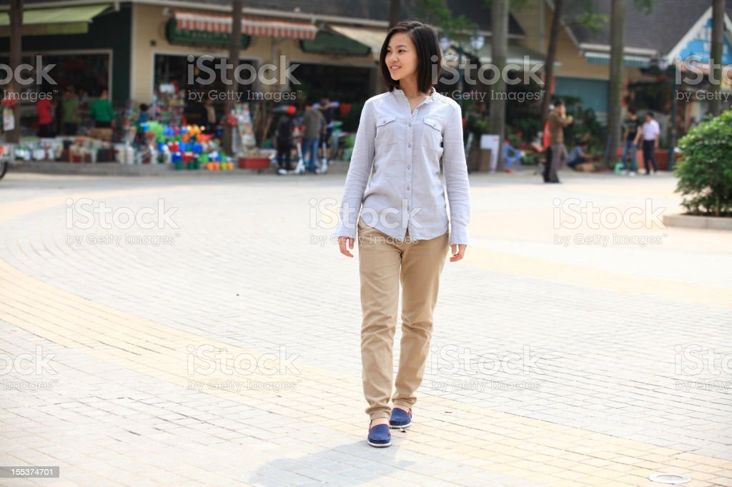 picture of young Asian woman walking in the downtown royalty-free stock photo