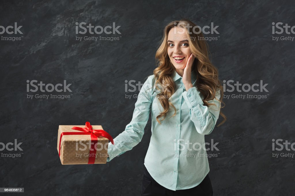 Picture of young excited woman with gift royalty-free stock photo