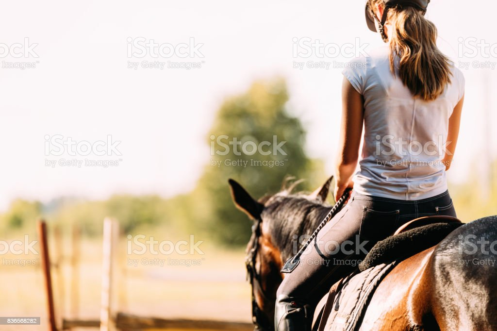 Picture of young pretty girl riding horse stock photo