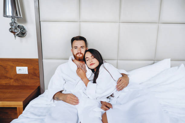 Picture showing happy couple resting in hotel room stock photo