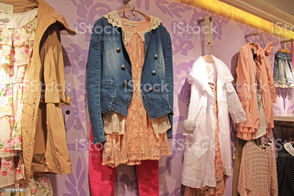 69d84224c90 Children s bright dresses hang on the display in the children s clothing  store - Stock image .
