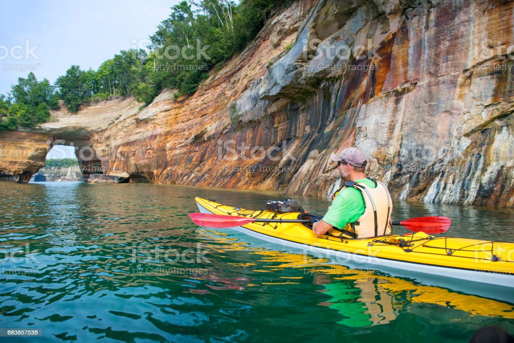 Pictured Rocks Kayaker Arch 2 stock photo