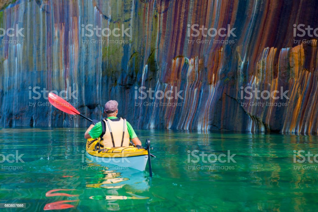 Pictured Rocks Kayaker Colored Cliff stock photo