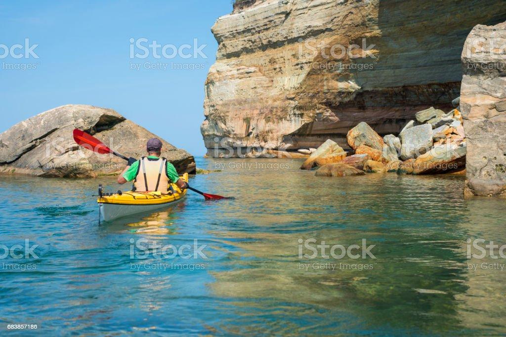 Pictured Rocks Kayaker Fallen Rocks stock photo