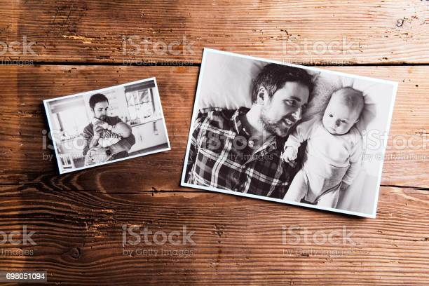 Pictures of father and baby wooden background fathers day picture id698051094?b=1&k=6&m=698051094&s=612x612&h=kyattfgj069ocolp0esey8juufpludg0p33fw5heq4c=
