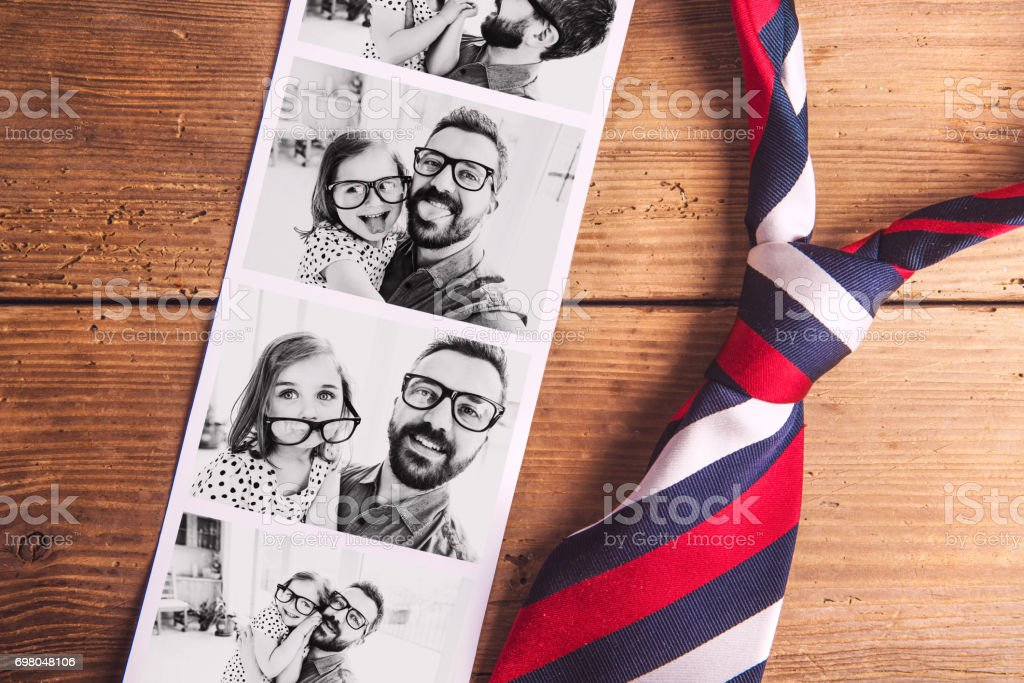 Pictures of father and daughter on table. Fathers day. Studio shot. stock photo
