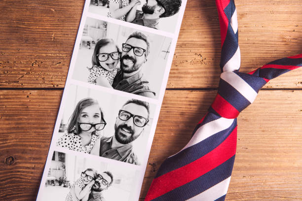 pictures of father and daughter on table. fathers day. studio shot. - fathers day stock photos and pictures