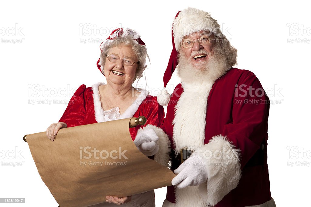 Pictures of Real Ms. Claus and Santa going over list stock photo