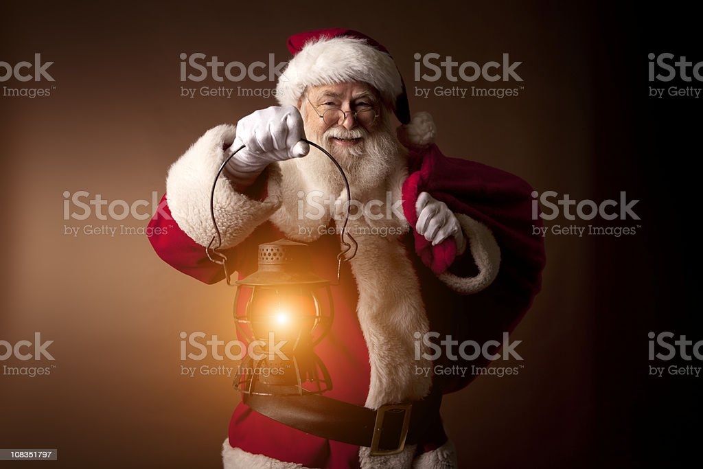 Pictures of Real Santa Claus carrying a lantern royalty-free stock photo