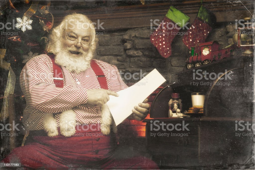 Pictures of Real Santa Claus checking his list twice royalty-free stock photo