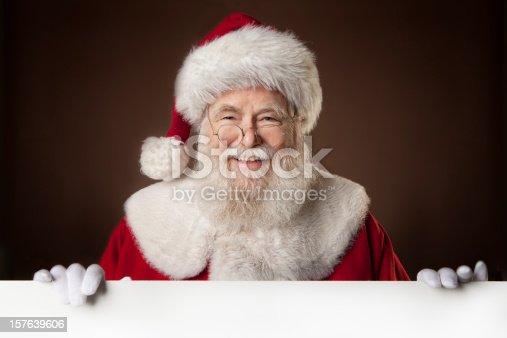 istock Pictures of Real Santa Claus holding a blank sign 157639606