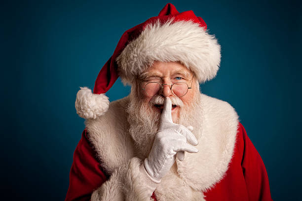 Pictures of Real Santa Claus with fingers on lips stock photo