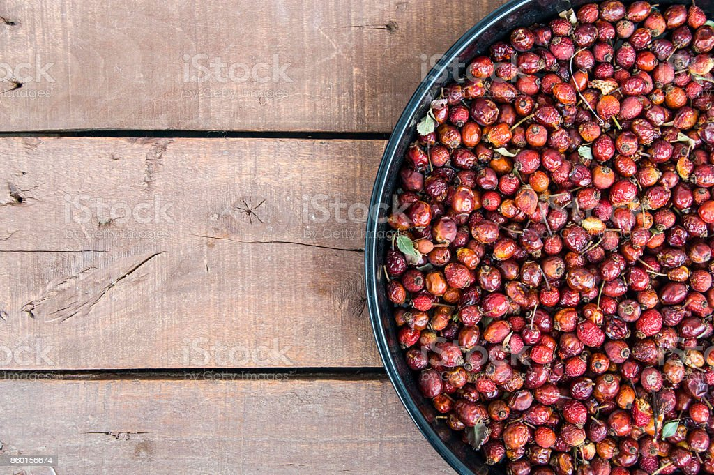 pictures of rosehip fruit dried in a tray, drying rosehip, drying rosehip to drink rosehip tea. stock photo