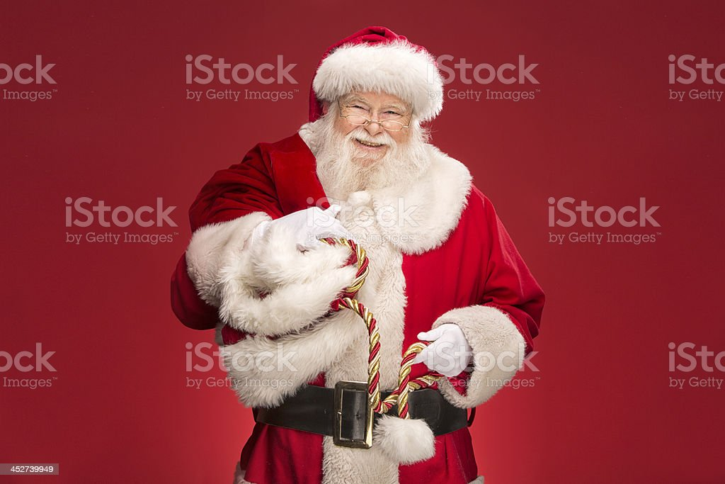 Pictures of Vintage Real Santa Claus carrying gift sack stock photo
