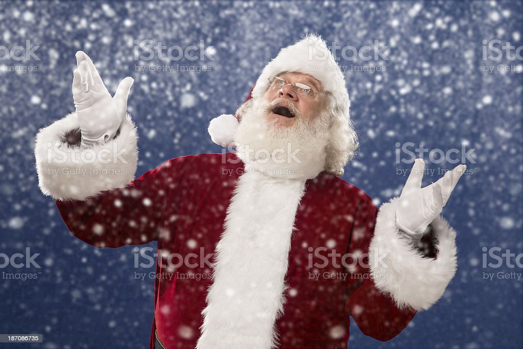 Pictures of Vintage Real Santa Claus catching snow flakes royalty-free stock photo