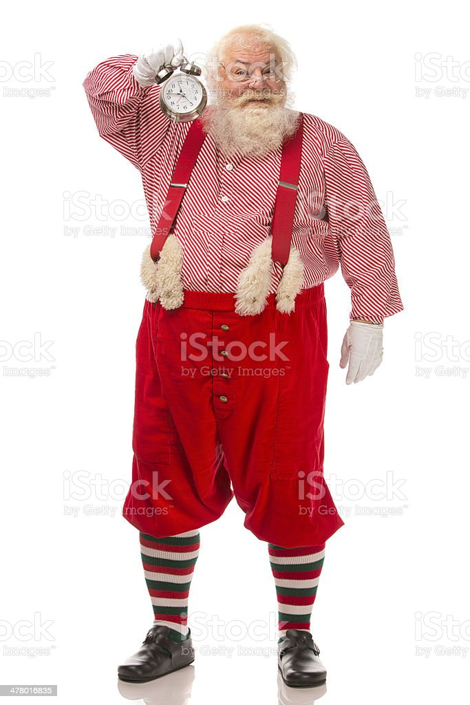 Pictures of Vintage Real Santa Claus holding clock royalty-free stock photo