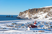 istock Picturesque aerial view of Vik I Myrdal church at the top of the hill in Iceland in winter. 1216432082