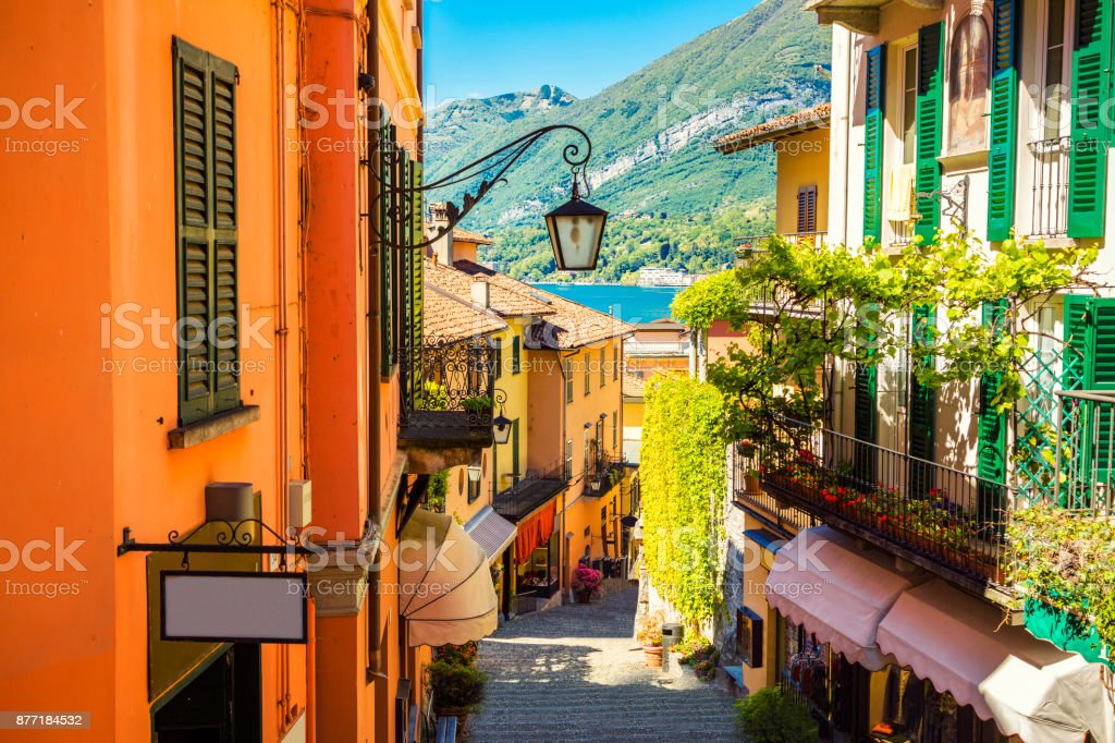 Picturesque and colorful old town street in Bellagio city in Italy stock photo