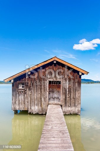 Picturesque boathouse on a mountain lake. HDR image