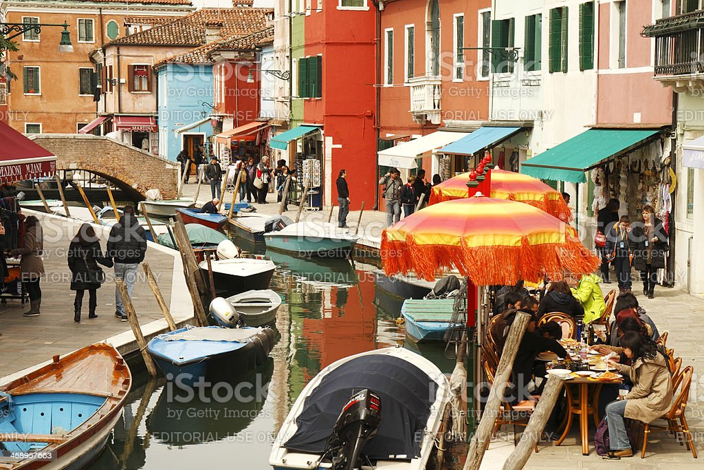 Picturesque canal with boats on Burano royalty-free stock photo