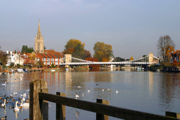 Picturesque Chilterns - Marlow England, Chilterns, Buckinghamshire, Marlow, the church and historic suspension bridge over the River Thames buckinghamshire stock pictures, royalty-free photos & images