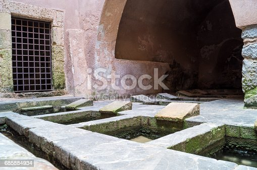 istock Picturesque cluster of 16th-century wash basins in Cefalu, Sicily 685884934