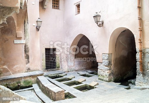 istock Picturesque cluster of 16th-century wash basins in Cefalu, Sicily 685902476