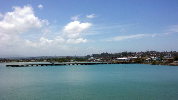A Picturesque Day in Puerto Limón A snapshot of a small town that overlooks the bay at Puerto Limón in Costa Rica. limoen stock pictures, royalty-free photos & images