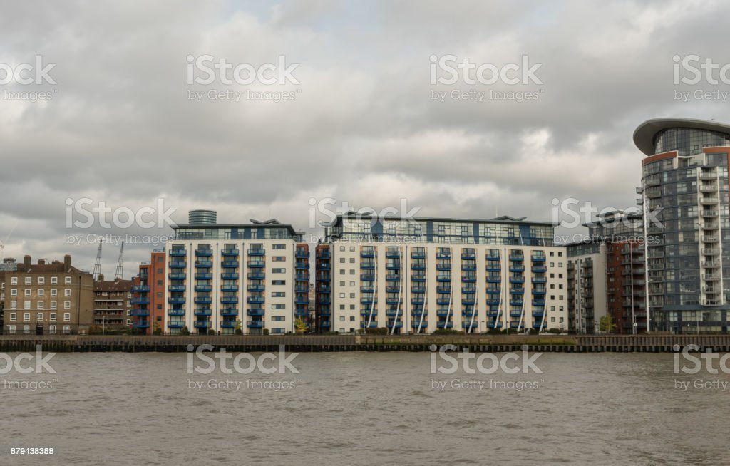 Picturesque East London buildings viewed from the Thames river stock photo