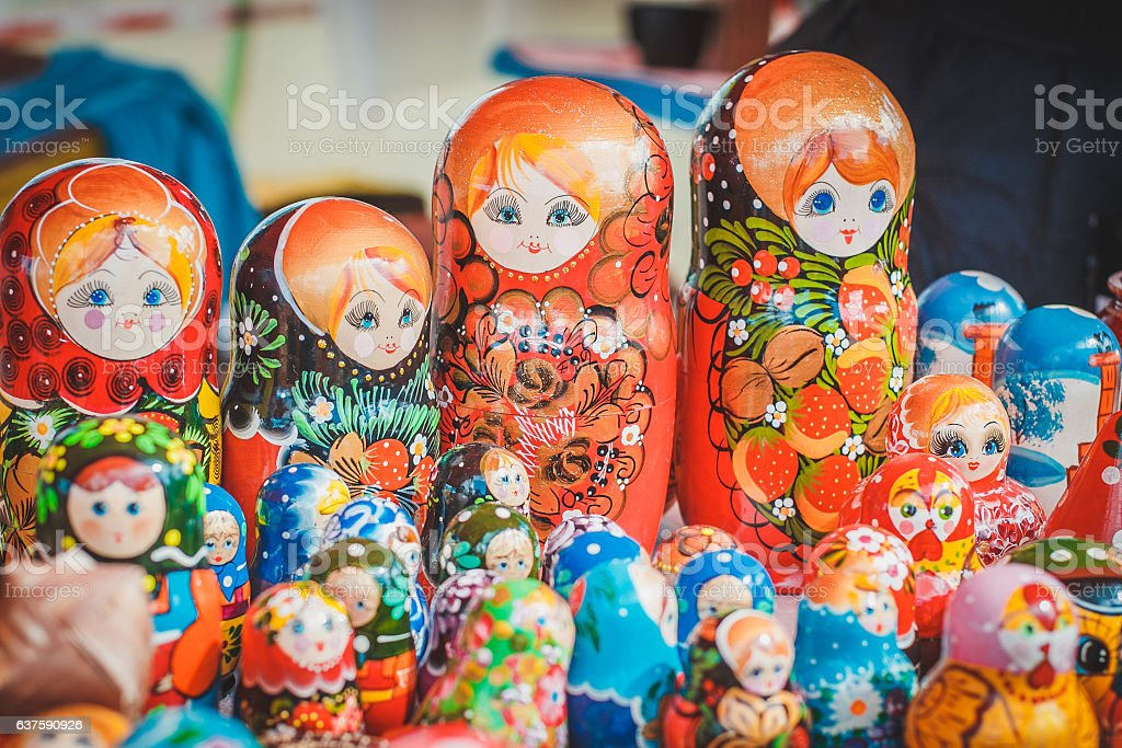 picturesque goods at a fair: Russian painted dolls stock photo