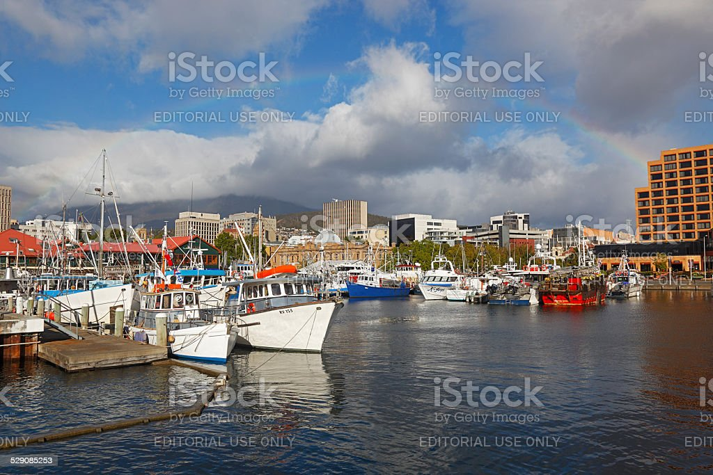 Picturesque Hobart Harbour with boats and rainbow stock photo