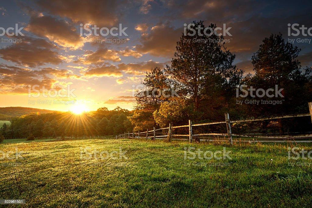 Picturesque landscape, fenced ranch at sunrise - Royalty-free Amerikan çiftliği Stok görsel