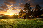 istock Picturesque landscape, fenced ranch at sunrise 522961501