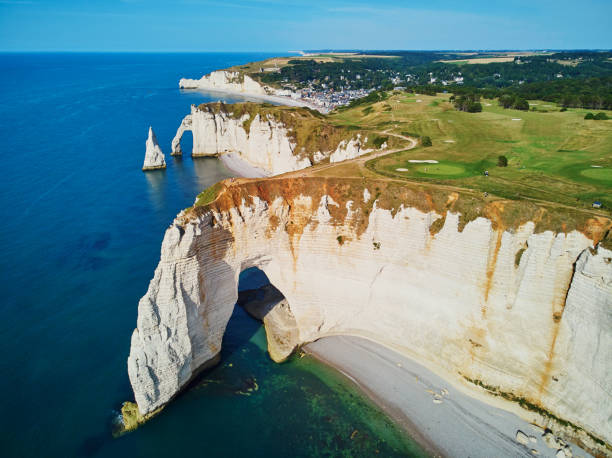 Picturesque landscape of white chalk cliffs and natural arches of Etretat, France stock photo