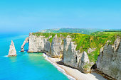Picturesque landscape on the cliffs of Etretat. Natural amazing cliffs. Etretat, Normandy, France. Coast of the Pays de Caux area in sunny summer day