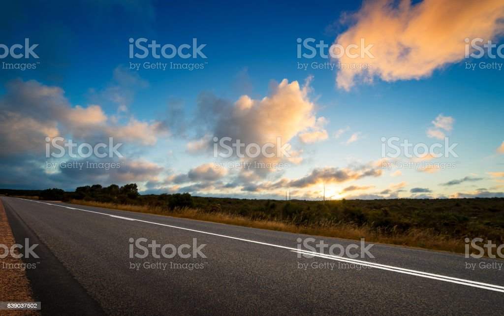 Picturesque landscape scene and sunset above road stock photo