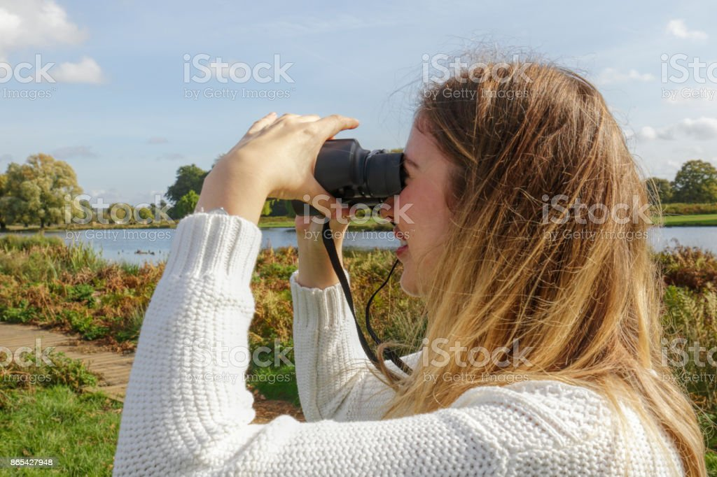 Picturesque landscape surveyed by beautiful blonde Bulgraian outdoor girl stock photo